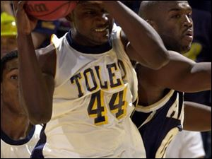 Toledo s Ricardo Thomas (44) rips a rebound away from Akron s Derrick Tarver. Thomas had 9 points.