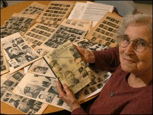 'This is history,' says Violet Gaige, with her new book and yellowed copies of the newsletter.