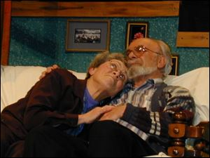 Norman and Ethel Thayer, played by Mark Deerwester of Fostoria and Peg Baker of Tiffin, share a tender moment.