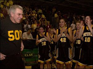 Northview s Jerry Sigler wears a smile and a shirt to proclaim his 500th victory. He is just the fourth coach in Ohio girls basketball history to do so. List on Page 8.