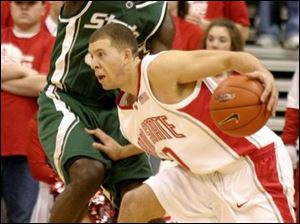 Tony Stockman drives around Michigan State s Kelvin Torbert. He leads Ohio State in scoring at 13.3 points per game.
