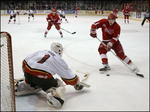 Johnstown goalie Arturs Irbe blocks a point-blank shot by Jim Abbott, but Rick Judson (center) scored on the rebound.