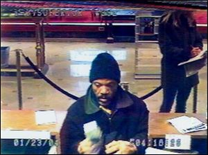 The suspect in a robbery of the KeyBank on North Superior Street in Toledo is captured on the bank s surveillance camera. The robbery occurred Jan. 23.