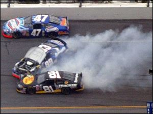Michael Waltrip, center, loses control of his Busch Series car during practice yesterday. Waltrip was not injured.