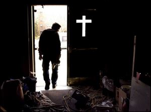 ROV Church Work  March 2, 2004-- A construction worker heads out of St. Joseph's Catholic church after finishing up some work Tuesday. The church at Erie and Locust streets is undergoing renovations. Blade photo by Andy Morrison