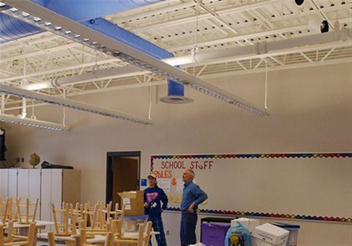 Elmwood Superintendent Dave Rossman Right Surveys The Middle School Art Room With Teacher Jennifer
