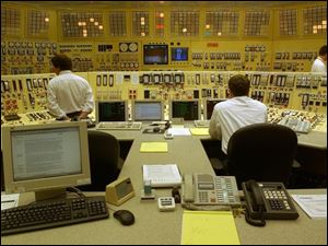 Reactor operators monitor and adjust operations in the Davis-Besse plant control room.