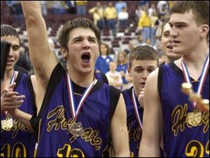 Ryan Fruth, left, proclaims Holgate's lofty position in the state while teammate Lee Brubaker takes the title in stride.
