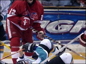 Atlantic City's Paul Falco loses the puck after being flattened by Toledo's Danny Eberly during the first period. The Storm avoided tying for the most losses at home in ECHL history.