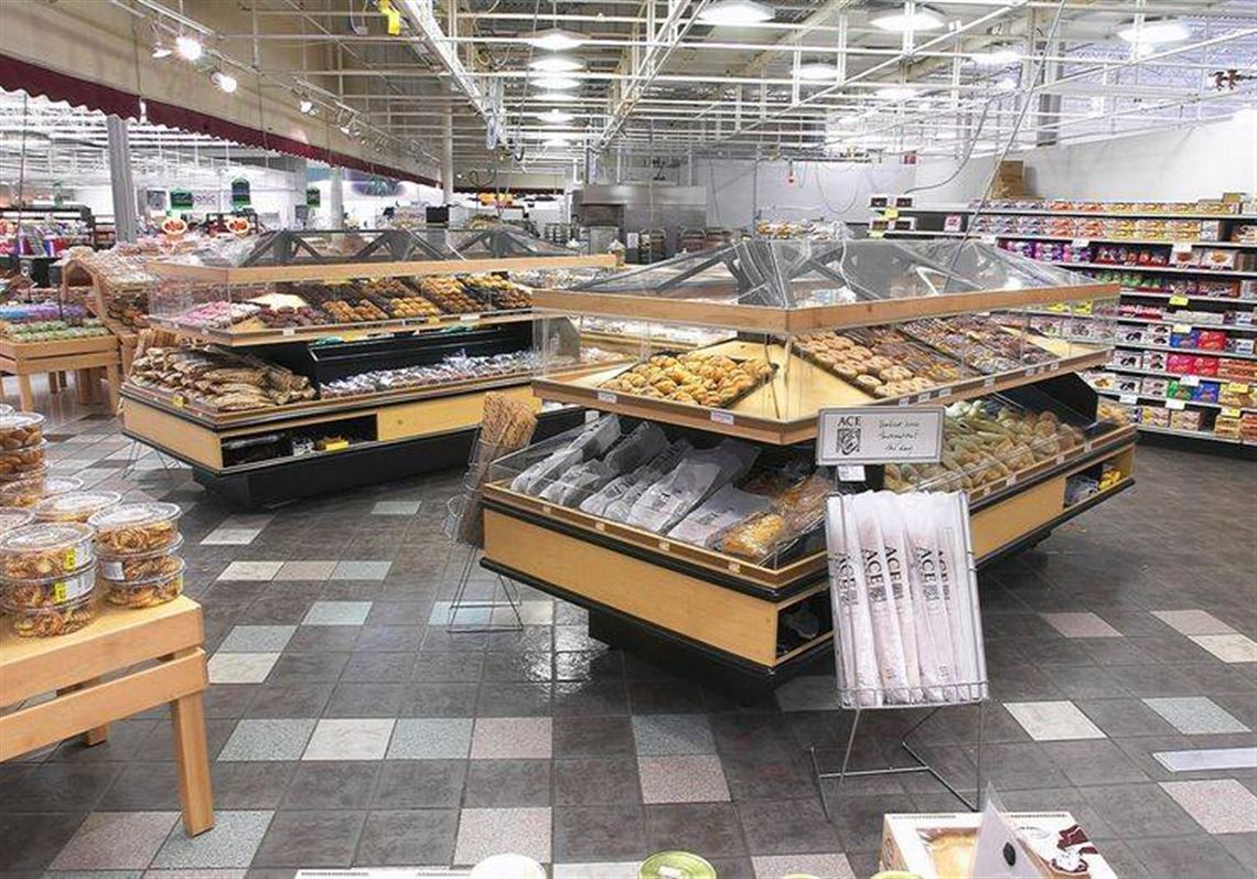Shiny Tile Flooring And Modernized Display Stations Are Part Of The Renovated Bakery Area In A