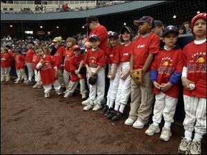 A long line of mini-Mud Hens patiently wait to be introduced along with the players as part of the Opening Day ceremonies at Fifth Third Field. The game drew a record 12,250 fans.