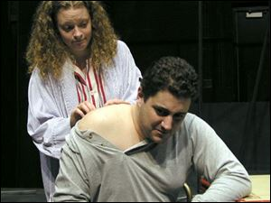 Maggie Welty as Claire and Brian Hillard as Limping Man in <i>Fuddy Mears</i> at the University of Toledo.