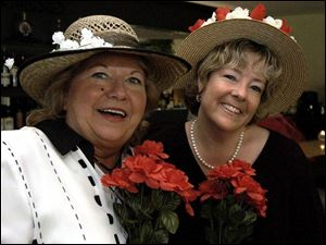 SPRINGTIME DERBIES: Dorothy Sheehan, left, and Lori Ruzicka show off their hats at Stone Oak Country Club.