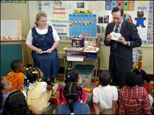 Gov. Bob Taft spends quality reading time with Anita LaLonde's kindergarten class at Sherman Elementary School in Toledo. The governor promoted reading as a tool for success.