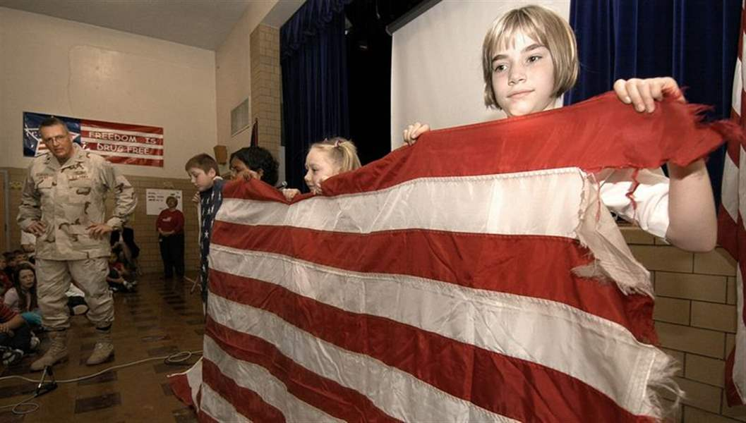 Colonel-gives-third-graders-flag-from-Iraq-Adopted-soldier-visits-elementary-school-2