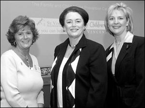 From left, Shelly Conyngham, Donna Woodson, and Susan Herring aid the Family and Child Abuse Prevention Center.