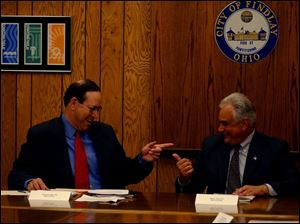 Gov. Bob Taft has a laugh with Mayor Tony Iriti during his visit to Findlay yesterday.
