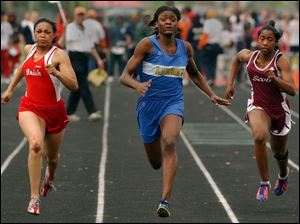 Libbey sophomore Danyelle McGary, center, swept the girls sprint events in the City League track championships last night at Start.