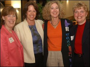 A NIGHT FOR CLAIRE: From left, Susan Morgan, Christine Brennan, Sandra Hylant, and Pam Hershberger pal it up at the library's main branch downtown.