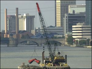Silt is dredged from the bottom of the Maumee River to keep the Toledo shipping channel open.