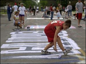 Brittant Rogerswas among the Bluffton seniors painting a street under supervision.