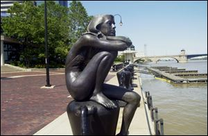 One of five figures in <i>Family</i>, by Penelope Jencks of Massachutsetts. The works are in Promenade Park downtown.