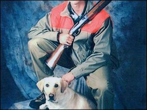 Matthew Dierker of Eastwood High School posed with his shotgun and yellow lab, Shy-Ann when he had his senior pictures taken. He wants to become a wildlife biologist.