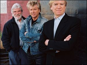 The Moody Blues, led by Graeme Edge, left, John Lodge, and Justin Hayward, will play Tuesday night at the Toledo Zoo Amphitheater.