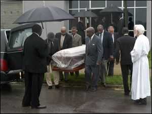 The body of William Brower, Sr., is carried from All Saints Episcopal Church after funeral services. Family and friends said good-bye during an emotional ceremony yesterday.