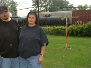 Dan and Judy Brown say railcars headed for a local landfill are supposed to haul construction debris but smell like trash.