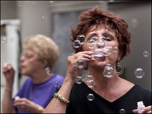 In the Focus on Healing class, Linda Rokicki blows bubbles as part of the breathing therapy.