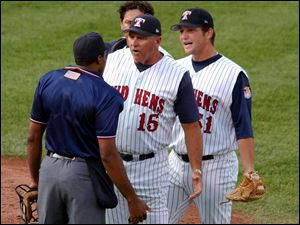 Manager Larry Parrish (15) has the Mud Hens playing hard, as evidenced by 15 come-from-behind victories. By JOHN WAGNER