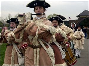 Volunteers in period costumes march into Fort Meigs during the May, 2003, rededication of the renovated War of 1812 fort.