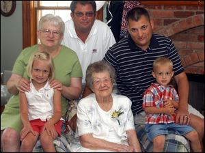 Five generations of the Yenrick family: front row from left, great-great-great-granddaughter Rebekah Yenrick, 5; Cornelia Palmer, 100, great-great-grandson Palmer Yenrick, 3; top row from left, daughter Jne Yenrick, grandson Robert Yenrick, and great-grandson Robert Yenrick.