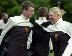 Mellophone players Justin Kyne, 18, of Bellbrook, Ohio, and Laura James, 21, of Gibsonburg, Ohio, stretch before playing.