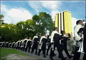 The Glassmen march through the UT campus before a recent competition.