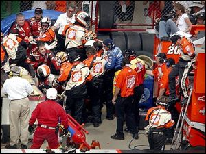 Members of Kasey Kahne's pit crew battled Tony Stewart's crew members Sunday after Stewart knocked Kahne into the wall.