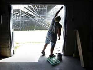 ROV regionpaint 01 - Dean Taft does some routine mainatinance at the Bowling Green fairgrounds in preparation for the upcoming Wood County Fair which starts August 2. Allan Detrich/The Blade