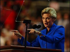 Michigan Gov. Jennifer Granholm addresses the Democratic National Convention at Boston's FleetCenter. She says she takes her responsibility as a role model for girls seriously.