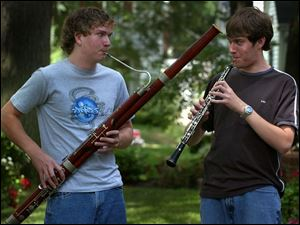 James Basel, 15, plays the bassoon and his brother Joe Basel, 16, the oboe in a practice session for the Ohio State Fair band.