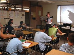 Instructor Katie Miller goes over a mathematics test with students at mason High School.