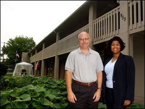 John Hoover, left, and Mary Price help provide services for the mentally ill via Neighborhood Properties, Inc.