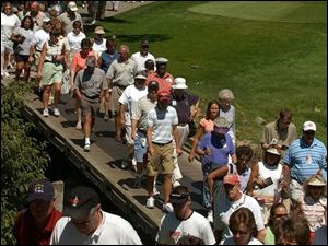 Golf fans flock to the first hole during the third round of the Jamie Farr Owens Corning Classic at Highland Meadows Golf Club in Sylvania. Thousands who turned out watched as Karen Stupples, winner of last week's Women's British Open, took the lead going into today's final round of the local tournament.