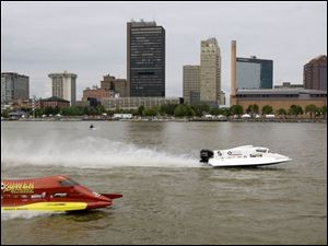 Jason Campbell, right, and Bill Rucker shoot up spray in practice for the Maumee River Roar.