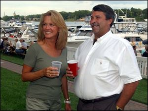 GOTTA REGATTA: Nancy and Vice Comm. Brent Schneider enjoy Maumee River Yacht Club's homecoming.