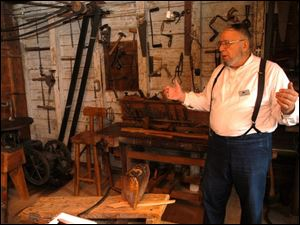 R sauder 1 .jpg Bill Collins of Montpelier gives a tour of Erie Sauders original workshop in Sauder village.  blade photo by herral long  8/17/2004