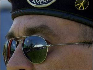 NBR viethall21p B  August 21, 2004-- Vietnam veteran Rick Wingle watches the Monroe County Vietnam War Museum Dedication Ceremony Saturday at Norman W. Heck Park in Monroe. Blade photo by Andy Morrison