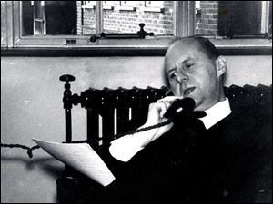 Journalist Fernand Auberjonois, who retired in 1983, dictates a story to The Blade from his London office in January, 1966.