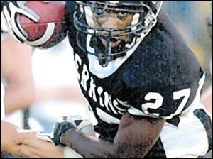 Perkins High School's Aaron Richardson runs for a touchdown in thsi 2002 photo.