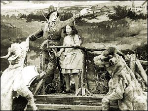 A scene from the 1910 film <i>The Wonderful Wizard of Oz</i> shows Dorothy, the Scarecrow, and other characters. The work, preserved by the George Eastman House, is the first surviving film of the novel by L. Frank Baum.